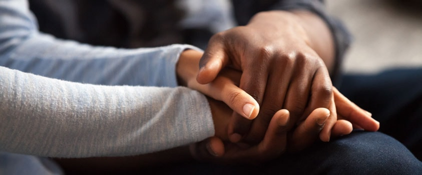 Holding Space - holding hands and showing compassion