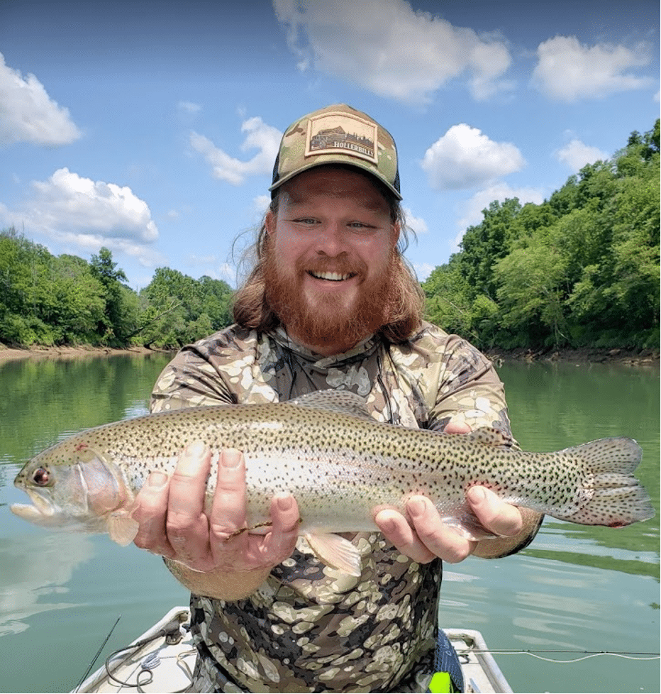 Oscar Minks holding a trout on the river